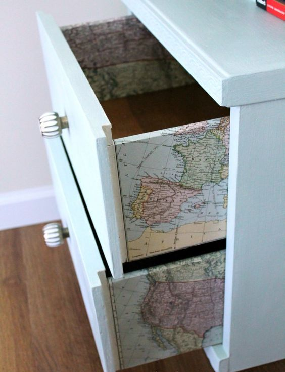 a dresser with vintage maps decoupaged is a fun idea that doesn't look too much - only for travel maniacs