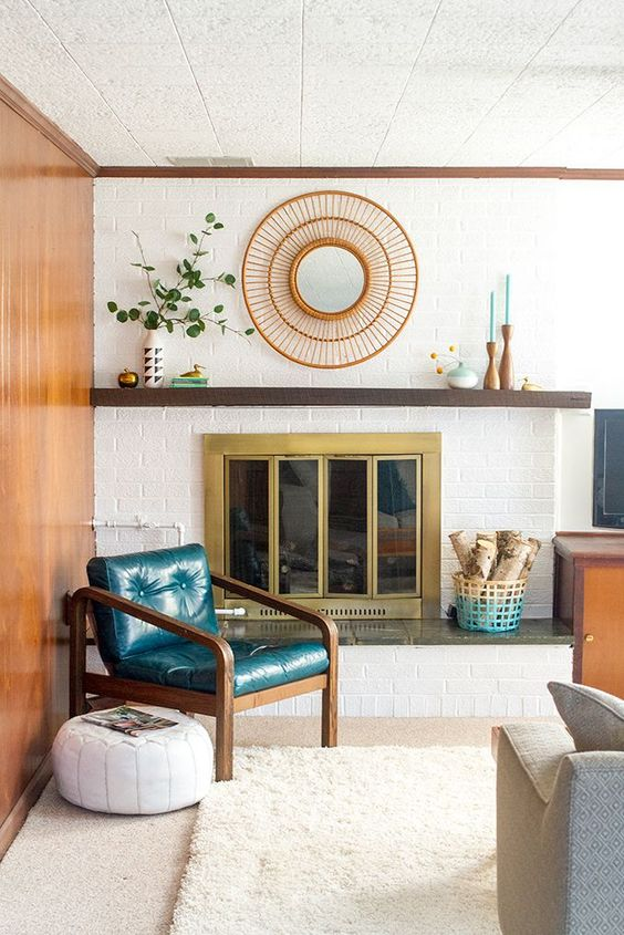 a mid-century modern living room with a white brick clad wall and touches of color to highlight it