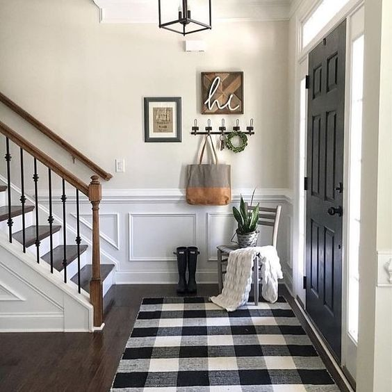 a small farmhouse entryway with a buffalo check rug, which is a cool idea to highlight the style