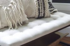 20 cozy macrame and braided pillows on an entryway bench will make your space very welcoming