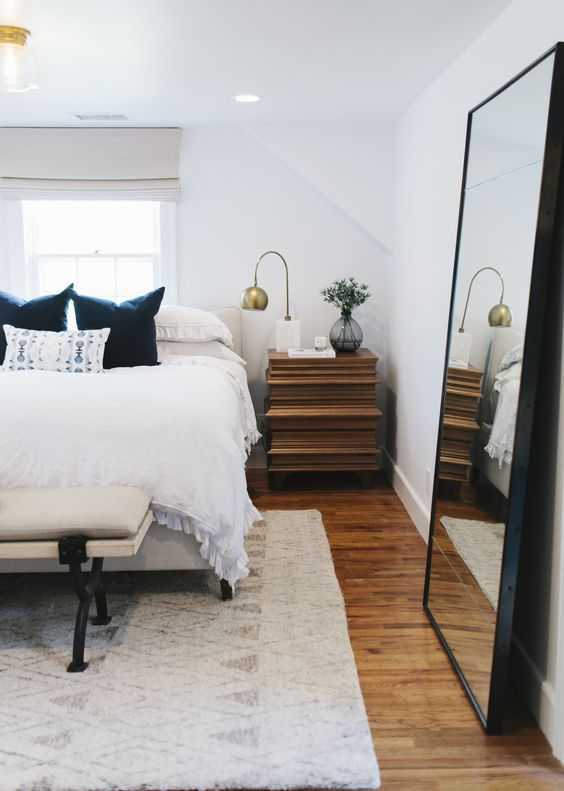 place a large mirror in your bedroom to double light and visually enlarge the space