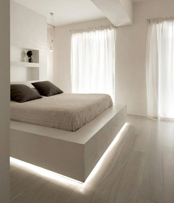 a floating bed highlighted with strip lighting is a chic contemporary idea and a cool way to add an edge to the bedroom