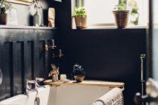 a bathroom with a cute vintage mirror