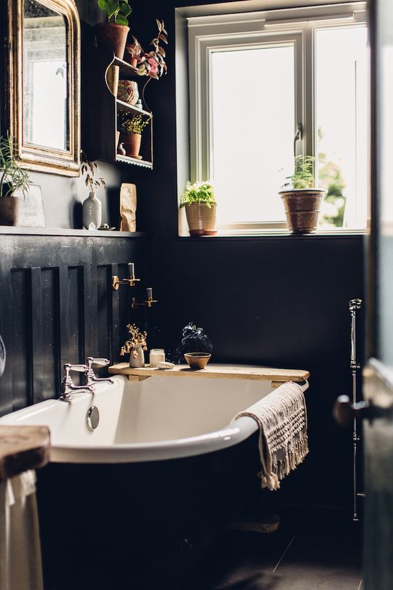 a mirror is a must for a bathroom, and it will also help you to fill your moody space with light