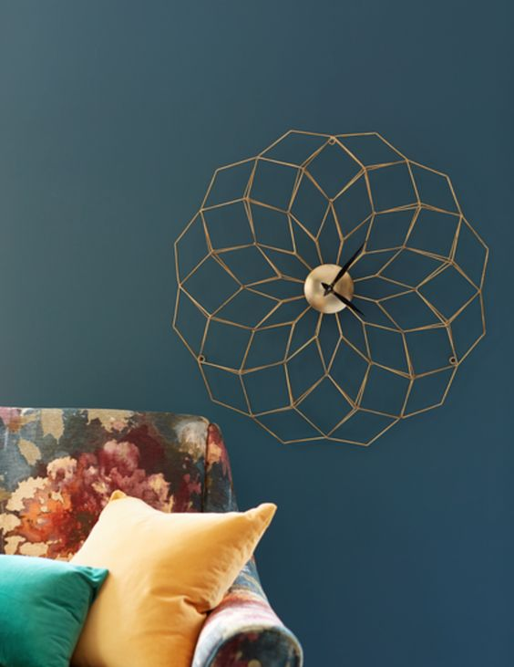 a stylish gold geometric clock is a subtle and chic wall decoration to rock in any room
