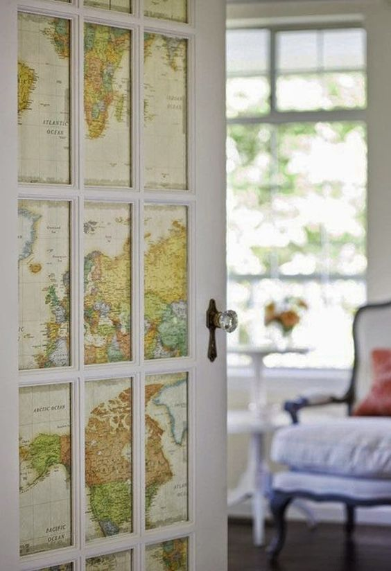 a door done with world maps instead of usual glass is a gorgeous travel-inspired idea to go for
