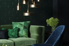 22 a refined living room with dark green, emerald and navy plus a cluster of brass pendant lamps