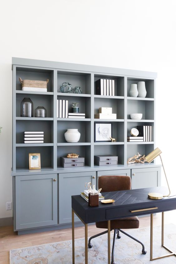 a slate blue shelf and storage unit is a great idea to add a touch of subtle color and give you storage space