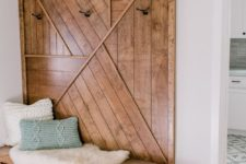 23 a bench and a matching wooden wall decoration – wood always brings a warm cozy feeling to the space
