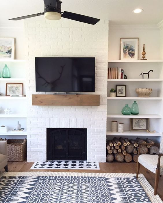 a farmhouse living room with a white brick wall and touches of wood and wicker for coziness