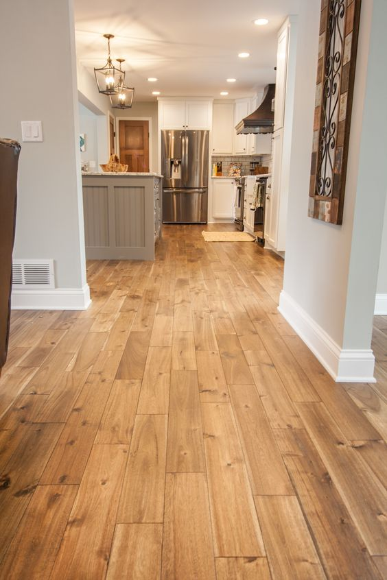 hardwood floors in some rich shade will make a statement in your space highlighting its beauty