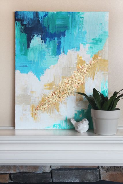 a bright artwork done with gold and gold glitter touches is a brigth idea to spruce up the space