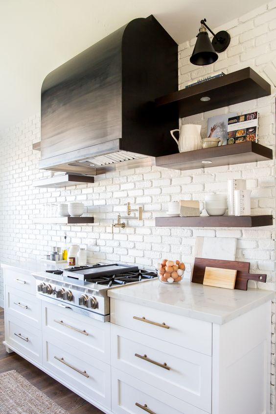 a chic farmhouse kitchen with a white brick statement wall that also acts as a kitchen backsplash