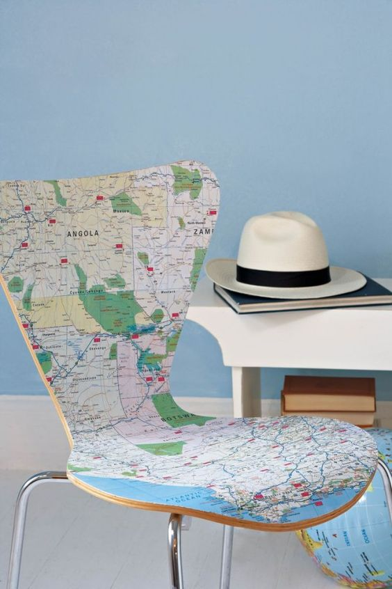 a modern chair covered with a world map is a cool and fresh idea for those who love to wander