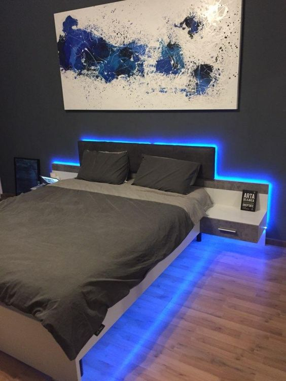 adding blue strip lighting along the bed abd under it will make your bedroom look ultra-modern and bold