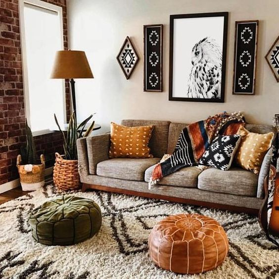 tribal artworks, a leather and suede Moroccan ottomans, woven planters and printed pillows to make the space free-spirited