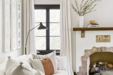 25 a 1920s Spanish-inspired living room with layered neutrals done in an analogous color scheme