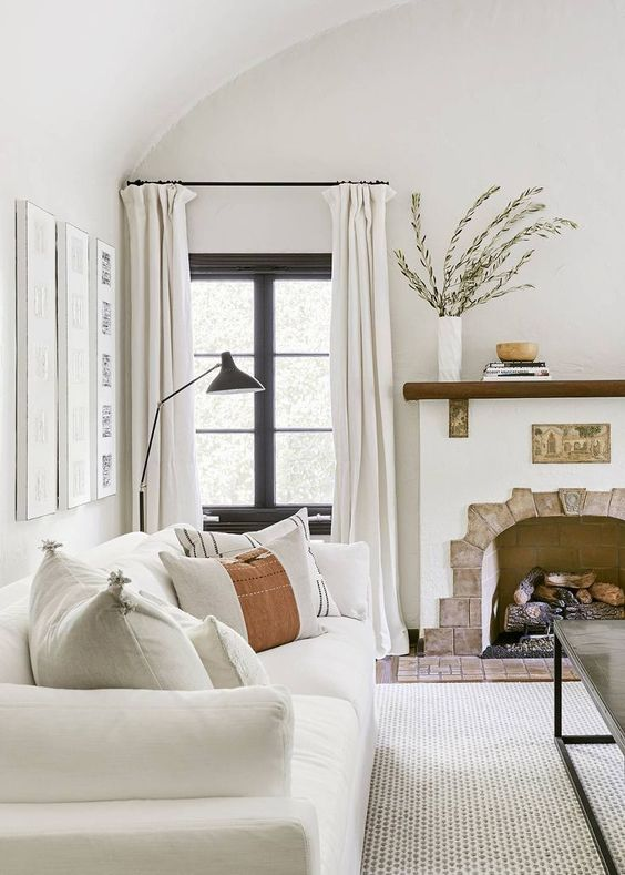 a 1920s Spanish-inspired living room with layered neutrals done in an analogous color scheme