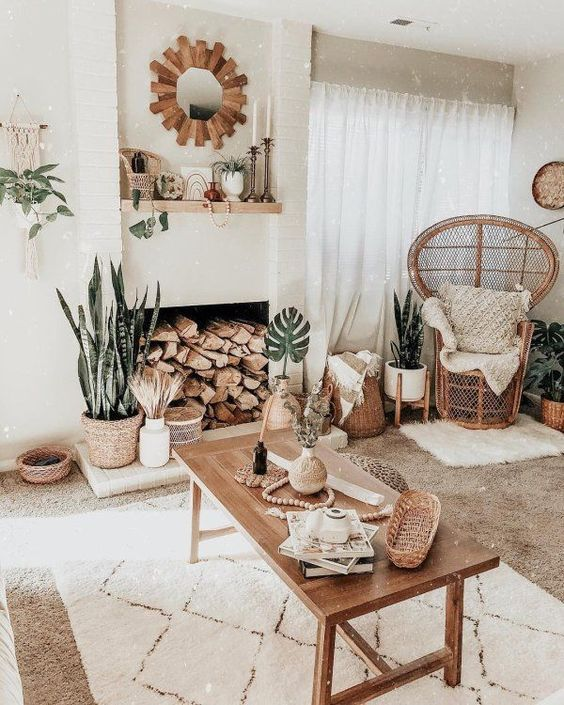a wooden frame mirror, potted plants, rugs and throws, many woven elements for a welcoming boho living room