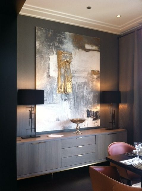 an oversized abstract artwork with touches of gold is a bright and chic idea to rock