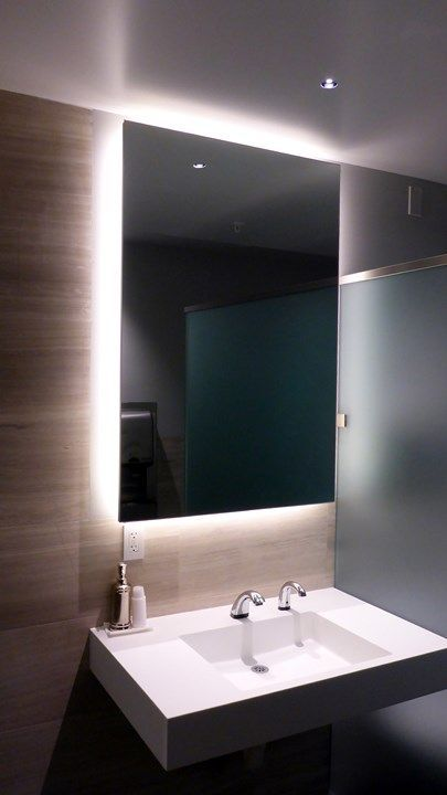 highlight the mirror in your bathroom with strip lighting to make your bathroom edgy and contemporary and add more light in the sink zone