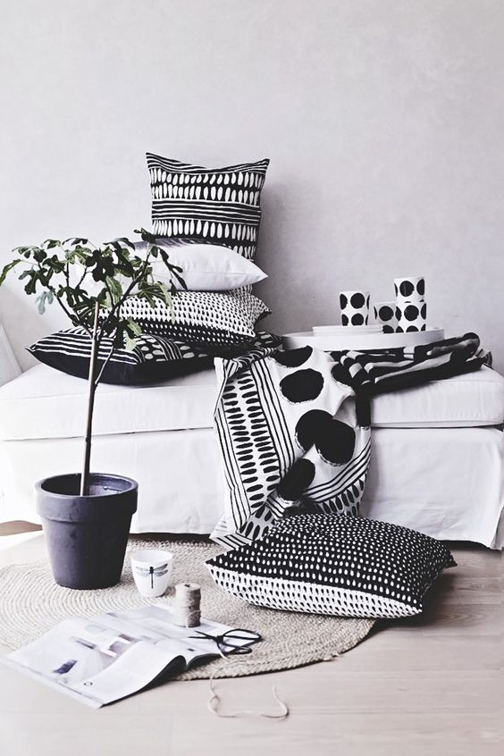 monochromatic pillows will cozy up a Nordic space in an elegant way and keep the style up