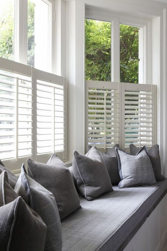 such half window shutters will keep you away from excessive sunlight while you are reading on this daybed