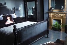 26 a dark moody bedroom with a couple of mirrors in heavy and carved frames for more light and more chic