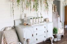 26 a vintage ladder with greenery and blooms plus potted plants make indoors feel like outdoors