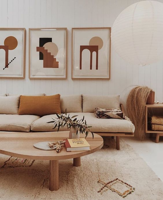 an analogous color scheme with neutrals, mustard and tan for a mid-century modern living room