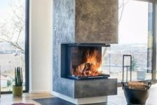 29 a modern fireplace like this one put in an open layout will make not one but two or more zones cozier