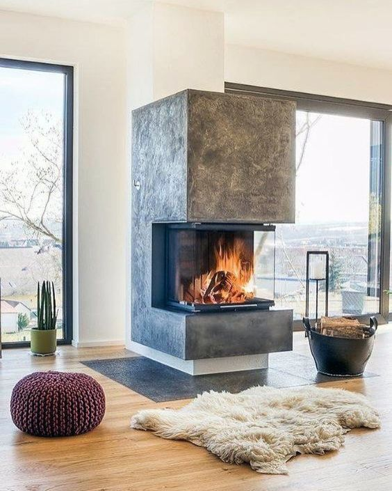 a modern fireplace like this one put in an open layout will make not one but two or more zones cozier