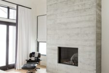 33 a built-in fireplace clad with weathered wood brings an inviting feel to the space and make it cozy