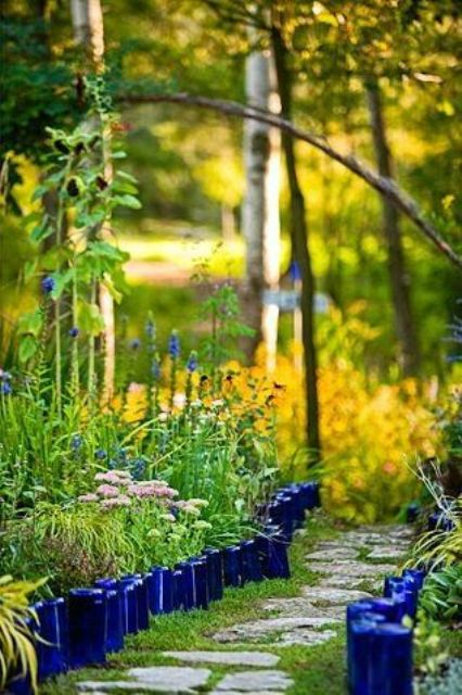bright blue bottle garden edging will bring much color and a relaxed rustic feel to your garden