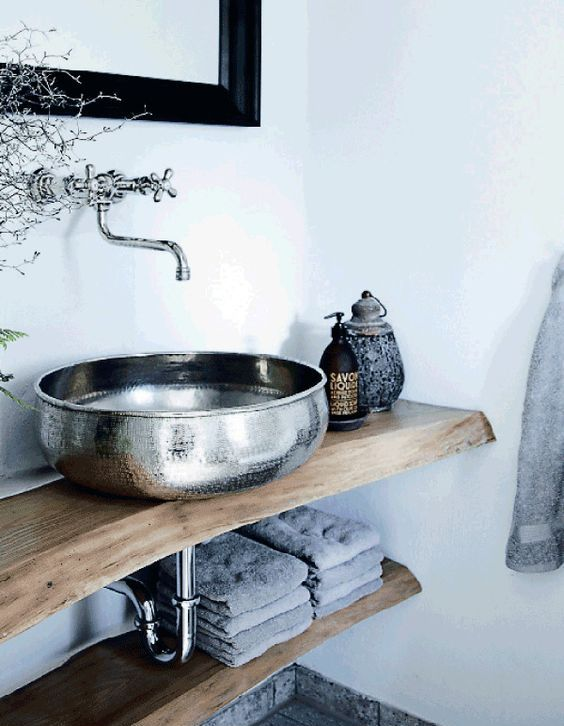 a beautiful hammered metal vessel sink will add a Moroccan feel to any bathroom, even the most casual one