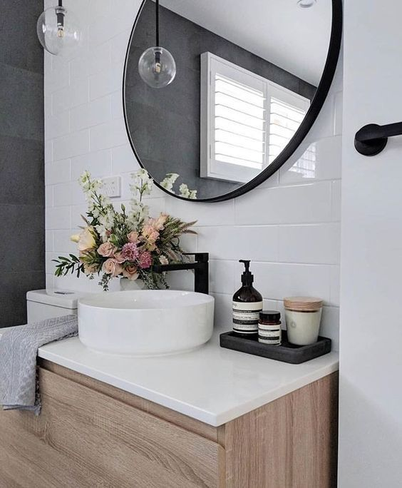 a classic white round vessel sink will never go out of style, pair it with black matte faucets for a contemporary space