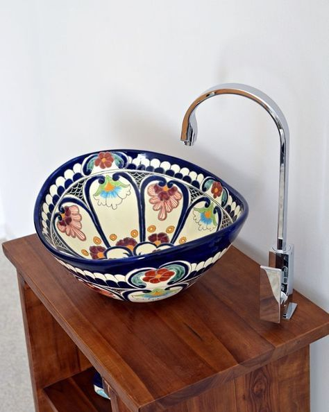 a colorful hand painted vessel sink is a beautiful idea for a Mexican-inspired or just bright bathroom