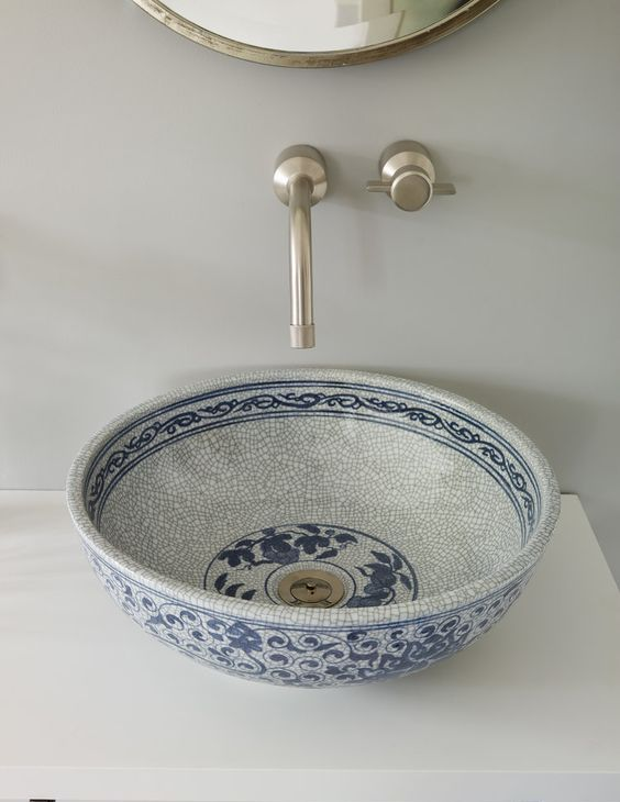 a gorgeous hand painted porcelain vessel sink in blues is a chic item to add a Moroccan feel
