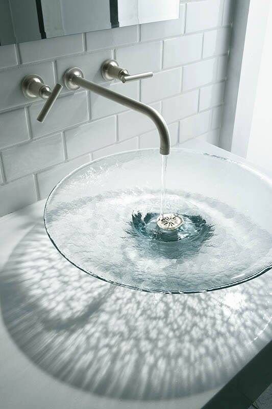 a large clear glass vessel sink will remind you of a water body adding a natural feel to the space