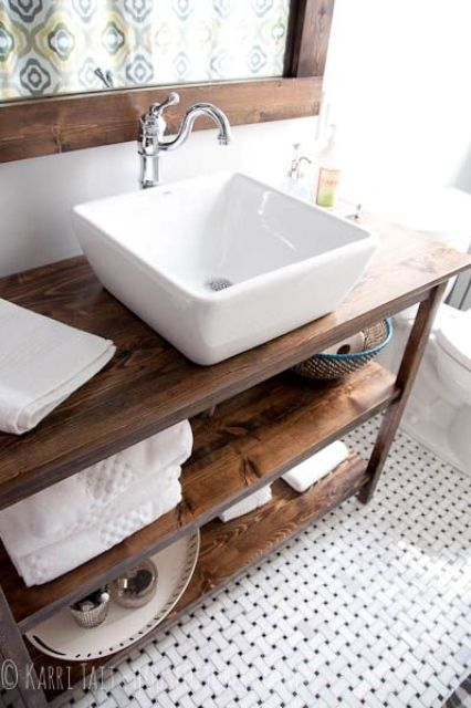 a large white square vessel sink immediately modernizes this rustic meets vintage bathroom