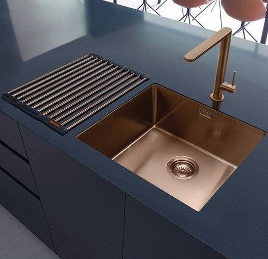 a sleek black cabinet and a copper undermount sink plus a matching faucet make up a chic moody combo