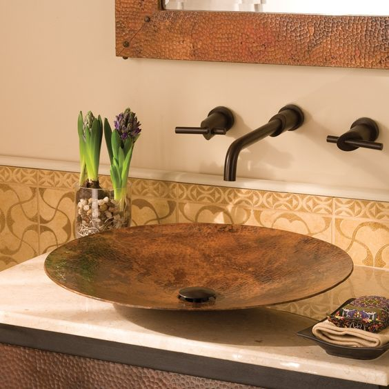 a sleek, contemporary copper vessel sink is wrought by master craftsmen using centuries-old techniques