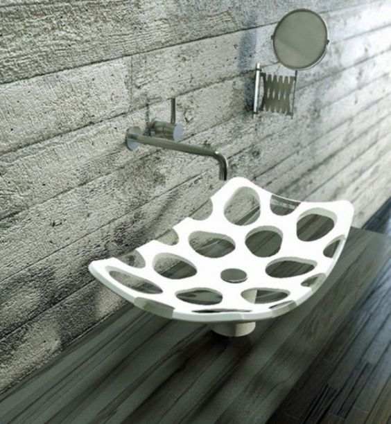 a white and sheer spotted vessel sink with a catchy shape will spruce up your bathroom even more