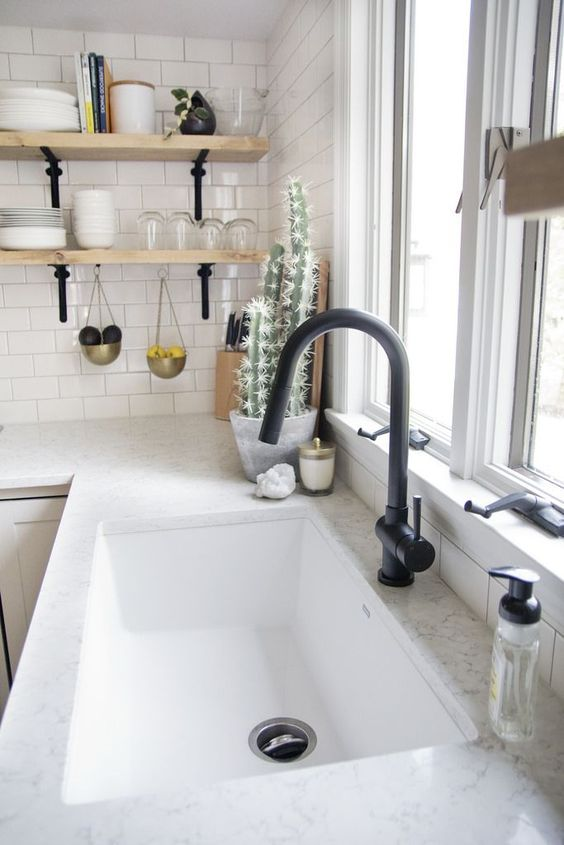 a white stone countertop plus a white rectangular undermount sink for a Scandinavian or minimalist kitchen