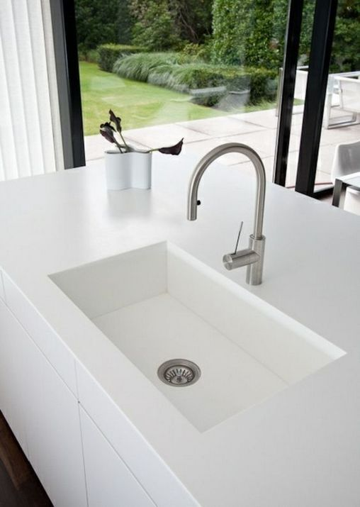 a white undermount sink in a white countertop create a perfect minimalist combo, which looks super laconic