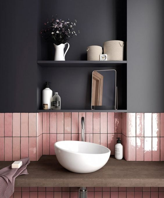 an asymmetrical white vessel sink catches an eye with its unique shape and makes the bathroom feel modern