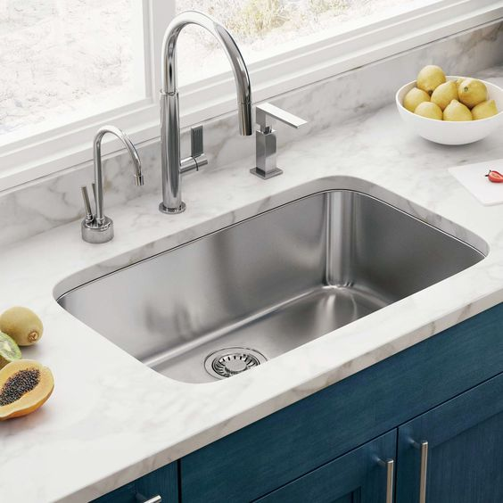 curved angles of this rectangular undermount sink give it a fresher and more modern look and feel