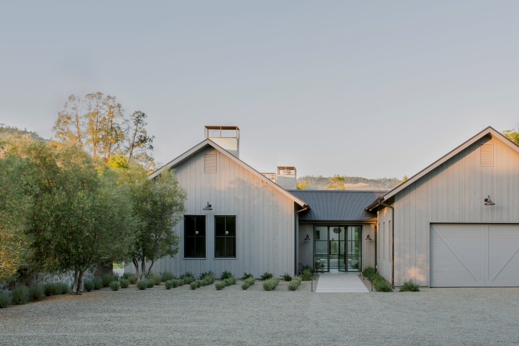 This residence is a modern take on traditional farmhouses that are seen in this area a lot and it looks amazing