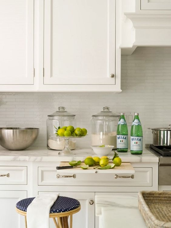 a beautiful white kitchen with a white skinny tile backsplash that glows and adds to the kitchen decor and matches the color scheme