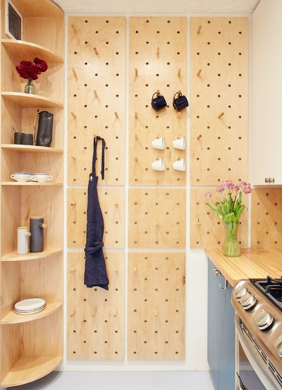 a built-in corner shelving unit with rounded shelves is a cool idea for a contemporary kitchen